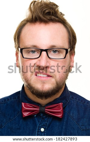 Headshot photo of white Caucasian male with a beard, blue eyes and brown hair. He is white, with a beard, wearing a bow tie,  shirt and glasses