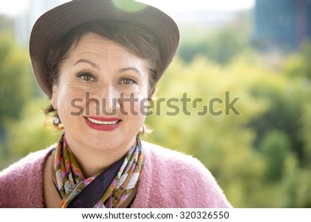 Headshot portrait of an amiable elderly woman smiling