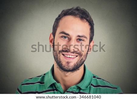 Headshot smiling modern man, creative professional isolated on gray wall background  - stock photo