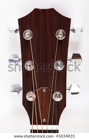 Headstock of a classical guitar over white background - stock photo
