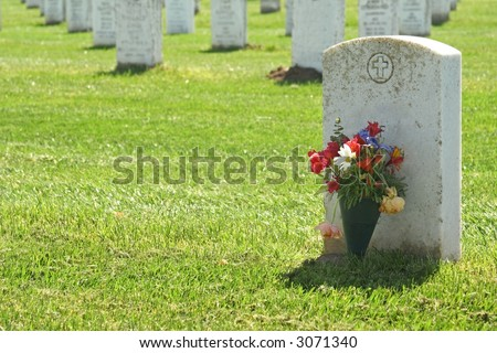 Headstone with Flowers, Military Cemetery - stock photo