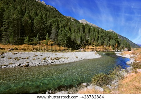 Headwaters of the famous Krimml waterfalls. Bluish - green transparent water glows in the midday sun. Austrian Alps - stock photo