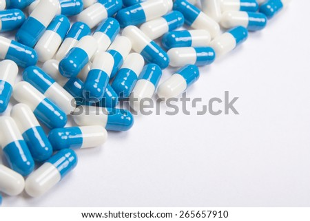 heal of blue pills or tablets on white background - stock photo