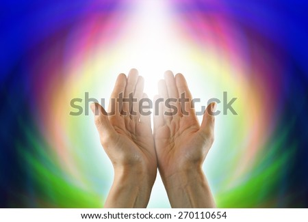 Healing Circle of Light - Female healer with hands open palm up surrounded by a rainbow circle of color and white light - stock photo