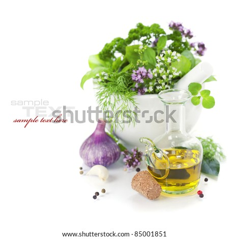 Healing herbs over white with copyspace (with sample text) - stock photo