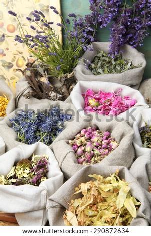 Healing medical herbs in a linen sacks. - stock photo