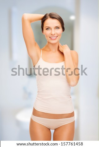 health and beauty concept - beautiful woman in beige cotton underwear - stock photo