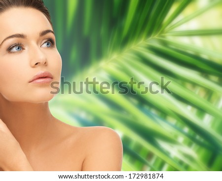 health and beauty concept - beautiful woman touching her face skin - stock photo