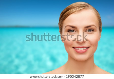 health and beauty concept - closeup of face of beautiful young woman