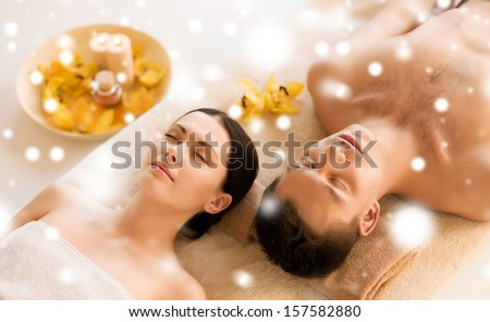 health and beauty concept - couple in spa salon lying on the massage desks - stock photo