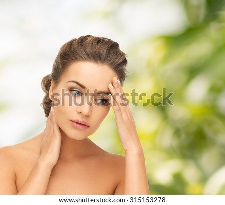 health and beauty concept - depressed woman holding hands on her neck and forehead - stock photo