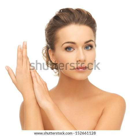 health and beauty concept - face and hands of beautiful woman with updo (can be used as a template for jewelry) - stock photo
