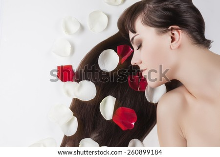 Health and Beauty Concept: Portrait of Relaxing Caucasian Female With Soft Silky Skin and Long Dark Hair. Horizontal Image Composition - stock photo
