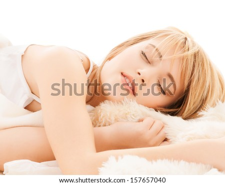 health and beauty concept - teenage girl sleeping at home - stock photo