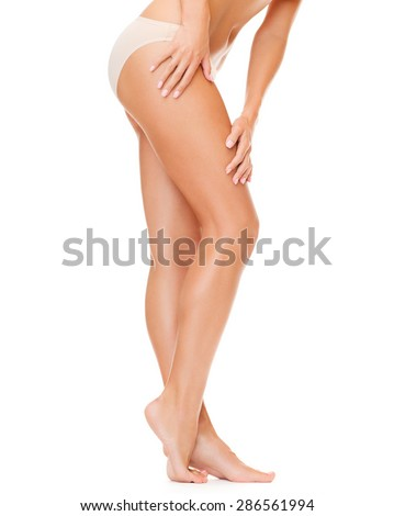 health and beauty concept - woman with long legs in cotton underwear - stock photo