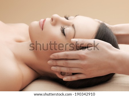health and beauty, resort and relaxation concept - asian woman in spa salon getting massage