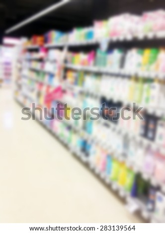 health and beauty shelves in supermarket lens blur background - stock photo