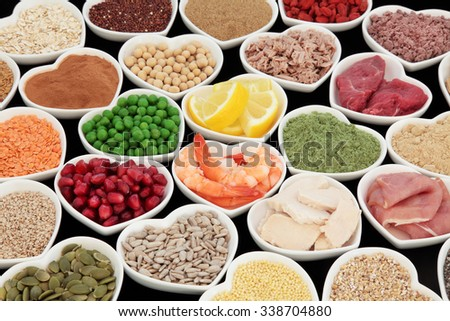 Health and body building high protein super food of meat, fish, with supplement powders, seeds, cereals, grains, fruit and vegetables. Selective focus. - stock photo