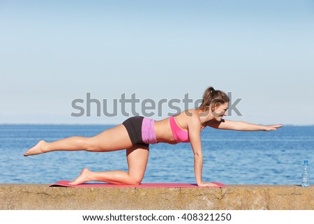 Health and body care idea. Sporty fit attractive woman with bottle of water after exercising workout outdoor.