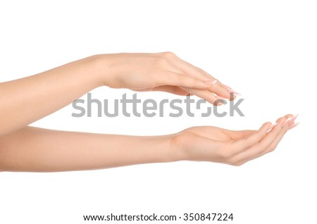 Health and body care theme: beautiful female hand with white cream isolated on a white background, hand massage