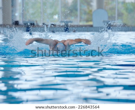 health and fitness lifestyle concept with young athlete swimmer recreating  on indoor olympic pool - stock photo