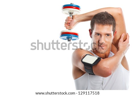 Health and fitness / Young man lifting weight and listening to portable music - stock photo