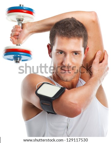 Health and fitness / Young man lifting weight and listening to portable music
