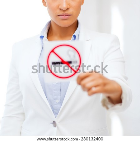 health and healthcare concept - picture of african woman with restriction no smoking sign - stock photo
