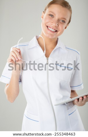 health and medical concept - woman doctor with stethoscope holding glasses and electronic tablet