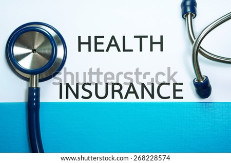 Health and medical insurance document in blue folder with stethoscope  - stock photo