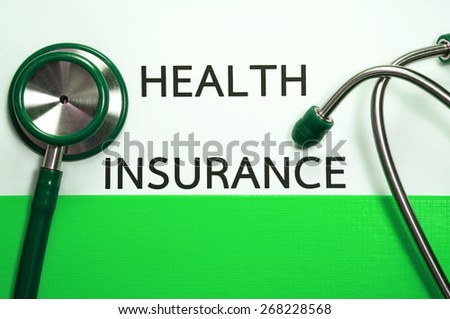 Health and medical insurance document in green folder with stethoscope  - stock photo