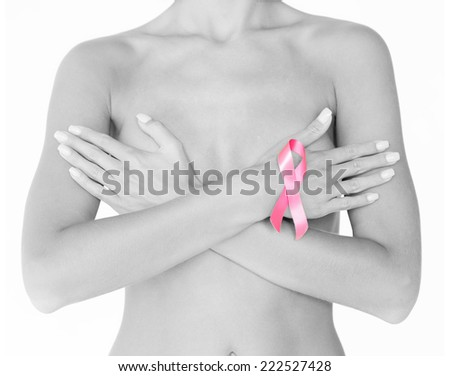 health and medicine concept - naked woman with breast cancer awareness ribbon - stock photo