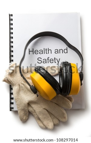 Health and safety register with earphones - stock photo