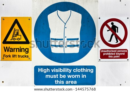 Health and safety warning signs at a construction site - stock photo