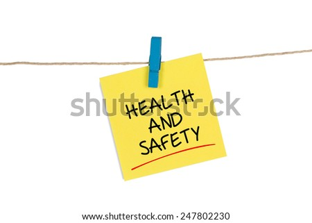 Health and Safety written on a Yellow Sticky Note Hanging Cord - stock photo