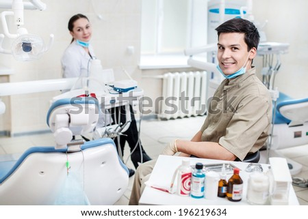 Health and smile.Portrait of a successful and confident dentist and assistant in a dental clinic - stock photo
