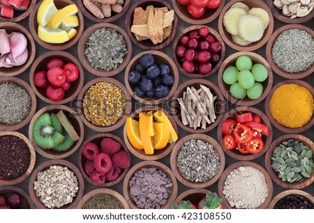 Health and super food  to boost immune system in wooden bowls, high in antioxidants, anthocyanins, minerals and vitamins. Also good for cold and flu remedy. - stock photo