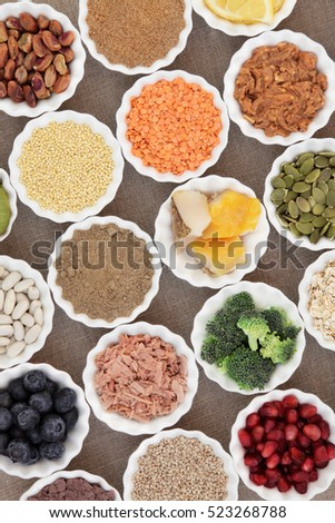 Health and super food with fish and meat, supplement powders, pulses, nuts, seeds, cereals, grains, fruit and vegetable selection. Also used by body builders.