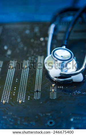 Health and Technology - Stethoscope on Circuit Boards - stock photo