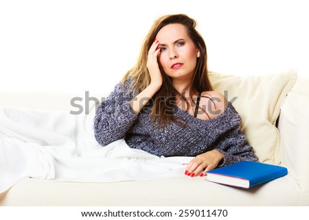 Health balance sleep deprivation concept. Woman lying on couch suffering from head pain taking power nap - stock photo