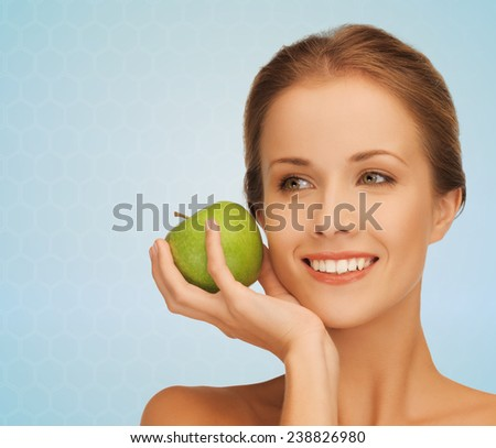 health, beauty, vegetarian food and people concept - smiling young woman with green apple - stock photo