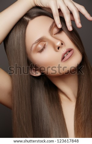Health, beauty, wellness, haircare, cosmetics and make-up. Beautiful fashion hairstyle. Portrait of woman model with shiny straight long hair and natural make-up