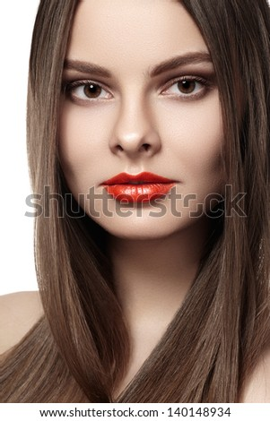 Health, beauty, wellness, haircare, cosmetics and make-up. Beautiful fashion hairstyle. Woman model with shiny straight long hair and red lips makeup