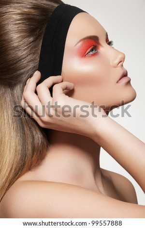 Health, beauty, wellness, haircare, cosmetics and make-up. Beautiful retro hairstyle. Woman model with shiny straight long hair and fashion make-up - stock photo