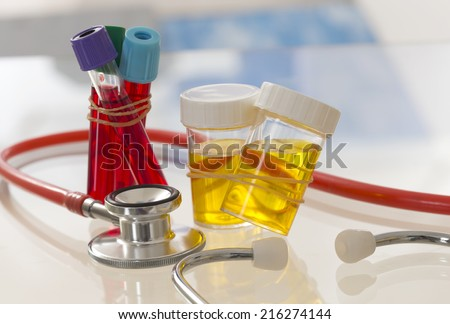 health care  and medicine symbol  - Urine Sample and Blood Test  - stock photo