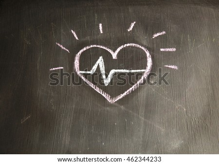 Health care concept and drawing of heart on blackboard.