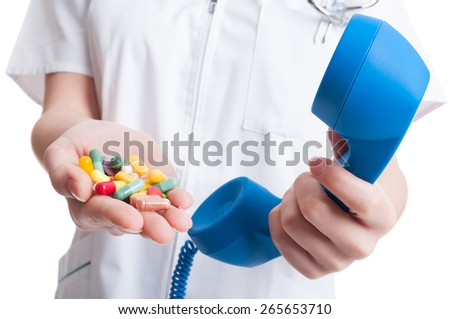 Health care concept or contact help concept with woman hand holding phone and pills - stock photo