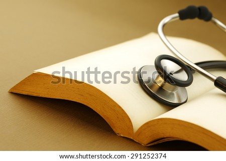 health care concept, Stethoscope with a medical book, shot with very shallow depth of field  - stock photo