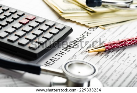 Health care costs. Stethoscope and calculator symbol for health care costs or medical insurance  - stock photo