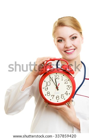 Health care medical checkup concept. Doctor with big red alarm clock reminding to do health check isolated on white